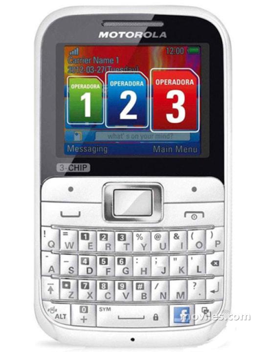 Fotografía grande Varias vistas del Motorola Motokey 3-Chip EX117 Blanc y Marron. En la pantalla se muestra Varias vistas